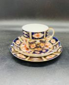 A Royal Crown Derby Imari pattern trio of plate cup and saucer dated marked for 1914. (3)