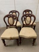 Four mahogany dining chairs