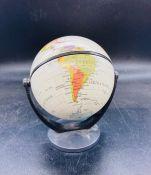 A small desk top globe