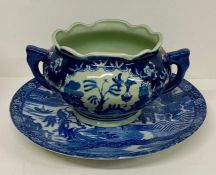 A blue and white platter with floral boarder(Dia 31cm) along with a two handle pot various ages (