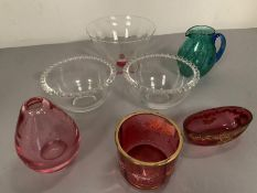 A selection of various coloured glassware