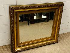 A giltwood wall mirror (63cm x 72cm)