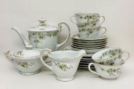 An Ohata China six place tea service, missing one teacup,