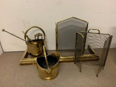 A selection of brass fire screens and tools