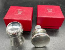 Two Roberts and Dore plated wine stoppers