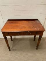 A mahogany wash stand on turn legs and drawers to centre AF (H79cm W90cm D49cm)Condition Report Chip