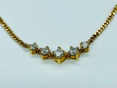 A Five stone diamond necklace on an 18ct gold chain (Approx weight of chain excluding pendant 5g)