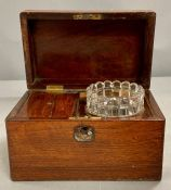 A rosewood tea caddy AF and a wooden cigar or cigarette box