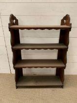 A floor standing four tier oak open shelves unit (88cm x 60cm)