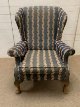 A George III style mahogany wing armchair