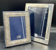 Two boxed silver photo frames