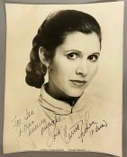 An autographed photo by Carrie Fisher from the estate of Keith Wilson Production Designer and Art