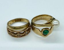 A selection of four 9ct gold rings in various settings and styles (Total Weight 9g)