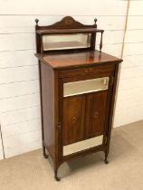 A mahogany music cabinet with mirror glass (H124cm W53cm D38cm)