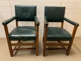 A Pair of British Library Reading room chairs with oak frames and stud detail. 57cm W x 91cm H