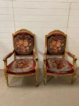 A pair of Louis XVI style carved giltwood open chairs