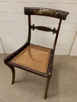 A brass inlay Regency dining chair, sabre legged