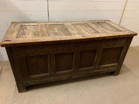 A 17th Century four panelled Coffer with hinged lid raised on bracket feet 135 L x 58 D x 63H