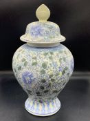 A blue and white ginger jar with shades of green (H34cm)