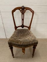 A Victorian dining chair with turned legs