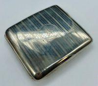 A hallmarked silver cigarette case, Birmingham, makers mark HWL