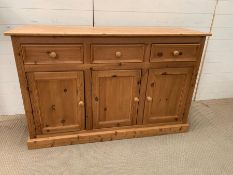 A Pine sideboard, three drawers over two cupboards. (H87cm W138cm D44cm)