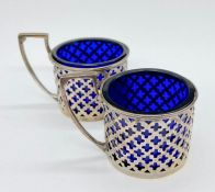 Two hallmarked silver mustards with blue glass liners