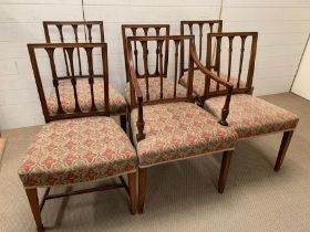 A set of 6 Sheraton mahogany dining chairs including 1 armchair, each with square back and 3