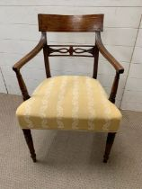 A Sheraton mahogany open armchair with broad top rail inlaid with boxwood stringing, horizontal
