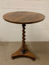 A rosewood occasional table on spiral centre support (H72cm Dia45cm)