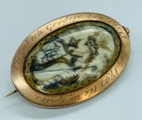 A late 18th century gold mourning brooch with weaved hair to one side and ivory decoted plaque to