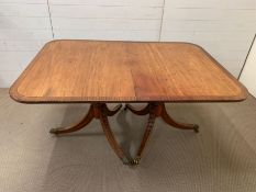 A George III mahogany 2-pillar dining table with rounded corners,crossbanding ebony stringing and