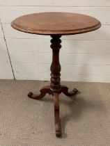 A mahogany occasional table on turn centre support on tri pod base