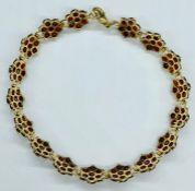 An 18ct gold and semi precious stone bracelet