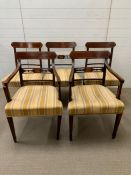 A set of 5 George III mahogany dining chairs (including 1 armchair) inlaid with satinwood banding