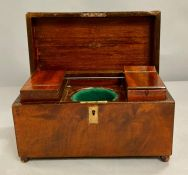 A mahogany tea caddy with inserts to sides (missing its glass liner)