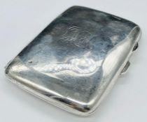 A Silver cigarette case by Joseph Gloster Ltd hallmarked for Birmingham 1925.