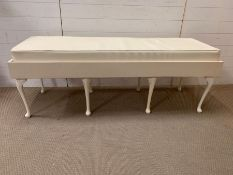 A white bench seat on cabriole legs and faux seat pad (H59cm W160cm D55cm)