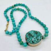 A Turquoise necklace, an early piece by Jane Diaz.