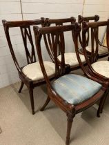 A Set of Six Empire swan carved Mahogany Chairs.