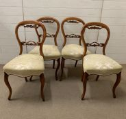 A set of four Victorian walnut dining chairs
