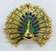 A enamel and diamante peacock brooch