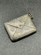 A silver, marked 925 envelope style stamp holder.