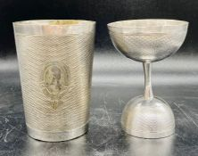 A white metal beaker and cup, machine tooled with blank cartouche.