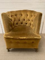 A Heptagon button back chair in velvet upholstery