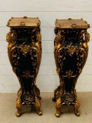 A pair of Italian gilt and ebony style lamp stands or plinths (H84cm Sq24cm)