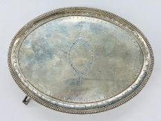 A Georgian silver teapot stand, indistinct makers mark, hallmarked for London 1786 on four legs. (
