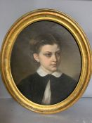 A 19th century American school, 'Portrait of a young girl', oil on painting, within an oval gilded