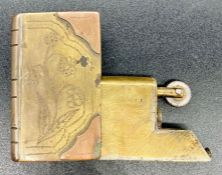 A Trench Art lighter in the form of a book.