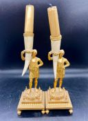 A pair of Delt and brass holders on square bases and bracket feet